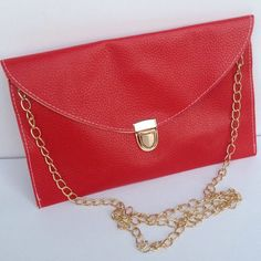 Envelope Clutch Purse Envelope clutch purse with golden chain which can be removable can be carried by hand or over the shoulder. Synthetic leather. Color red. New! Boutique Bags Shoulder Bags