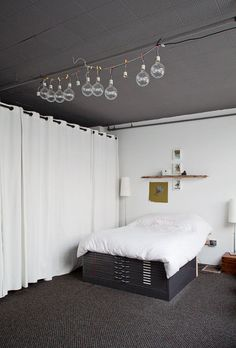 I love this studio/apartment space. The flat file, the antlers, the art, the natural elements with the industrial man made.... I want to live here.