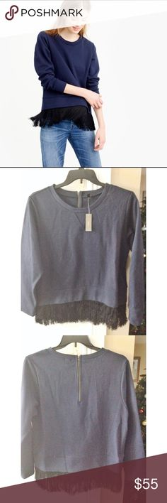 J. Crew Sweatshirt with Black Fringe NWT. Size XL. Navy color with black fringe. Super Chic.  Fabric: 56% cotton 44% Polyester  Tassels: 100% Nylon  Measurements: Pit to Pit: 23 inches across Shoulder to shoulder: 17.5 inches Sleeve length: 23.5 inches Length: 27 inches J. Crew Sweaters