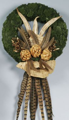 I love neutral fall wreaths!!! ..... I also love artichokes, & to go uneaten long enough to dry & join the marvelous pheasant feathers in this beautiful creation would be nothing short of a miracle ... ;-) ... Another reason to buy them dried! ... along with the okra pods & giant flat mushroom pieces .....