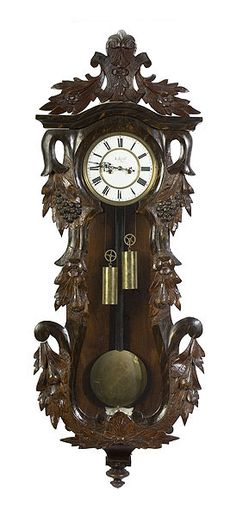Carved Vienna regulator wall clock, at Cowan's Auctions