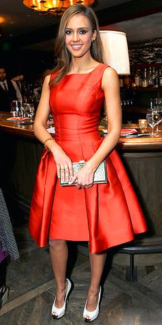 Jessica Alba spices up her cocktail dress in a vivid hue.