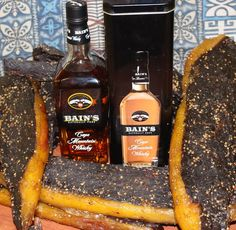 Making quality biltong in your biltong maker. Cut meat into strips, spice and hang the next day for perfect biltong. Biltong, Charcuterie, Whiskey Bottle, Spices, Fat, Yellow, Drinks, South Africa, How To Make