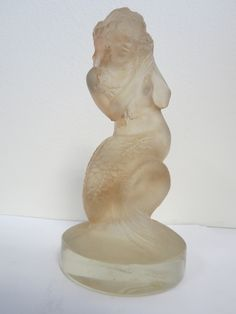 'Naiade' watermaiden/mermaid as a desk ornament and later adapted as a car mascot.