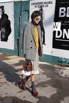This look has a great 60's vibe to it, It may be the dogtooth double brested jacket, the pleated skirt, the oversized sunglasses or maybe its just the pleated skirt, either way we love it!