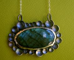 Labradorite necklace with hand-domed sterling silver discs around it! I love how the oxidation on the silver goes with the stone!