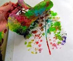 Paint a leaf with different colors....it leaves a print that looks like a tree!