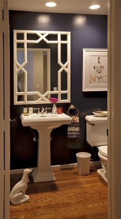 Hollywood regency influenced powder room with navy blue gloss walls and white accents.  Don't love the extreme contrast, but do in a more traditional style/colors to get a good feel.