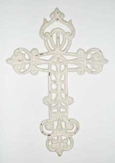 Crosses now available! Beautiful hand cast iron cross with an ivory antique finish. Perfect to collage on an accent wall, or hang up solo. $24