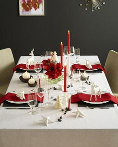black, red and white table setting with bold florals and white ornaments for a traditional twist
