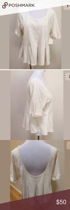 NWT We The Free Ivory Cropped Pleated Top NWT We The Free Free People Ivory Cropped Pleated Short Sleeve Top Women's Large.  Brand new. Low back. Pleated around waist. Cropped. Clean and comes from smoke free home. Questions welcomed. Free People Tops Crop Tops