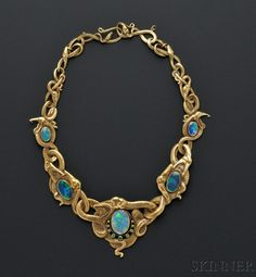 Art Nouveau 18kt Gold, Opal, and Demantoid Garnet Necklace, designed as writhing serpents with five bezel-set opals, the central opal with demantoid garnet accents, lg. 16 1/4 in., maker's mark RD within a shield.