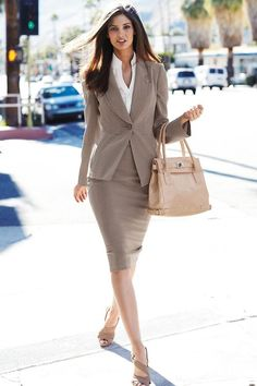 A beige suit that is perfect for an interview. Be sure that blouse underneath is not cut too low.