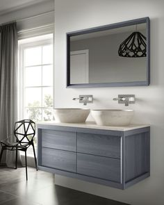 Sleek, contemporary lines are the basis of the Dogi Fontane collection. The extensive range includes suspended base units and hanging floor-bearing base units, endowed with spacious drawers, all finished in solid ash wood and treated with water-based and acrylic paint. #bathroomfurniture #bespokefurniture #bathrooms