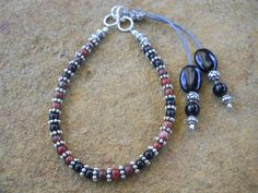 Black agate, red chrysocolla and silver-plated brass bead bracelet with black agate clasp detail. $23 (BR7) www.feeko.co.za