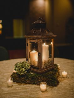 Rustic fall glass lantern centerpieces with flowers