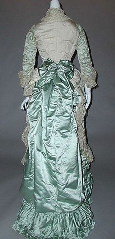 Dress Date: ca. 1880 Culture: French Medium: silk Dimensions: Length: 63 in. (160 cm) Credit Line: Gift of the Estate of Jane Curtiss Breed,...