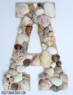 Seashell Letters - if you don't have shells, pick them  up at the craft/dollar store! #kidscrafts #merrymonday