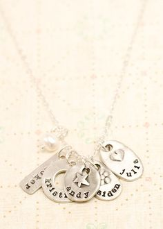 jumble of charms necklace...have one with my children and grandchildrens names:) lisa leonard designs