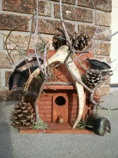 antler and turkey feathers birdhouse