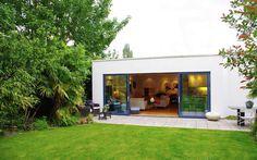 Stark modern exterior leading onto living room by LLI Design on http://roomreveal.com
