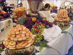Down South Delights Appetizer Fruit Table http://ashleysbrideguide.com/nashville-wedding-ideas/image/down-south-delights-pink-table-cloth-with-multicolored-food-trays2/ GREAT PARTY SITE