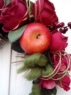 Ghirlanda mele rose bacche