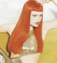 Love the Betty Page bangs & rockin' red color!