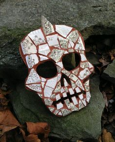 Dishfunctional Designs The original contemporary jewelry and mosaic decor handcrafted from broken vintage china...  Artist made broken china mosaic mohawk sugar skull wall decor made with gold trimmed floral china.  This unique mosaic hanging skull wall art was handcrafted from antique and vintage china. Handcrafted wood base and dark cinnamon brown colored grout. Measures approx. 5.5 by 8 Arrives ready to hang with saw tooth hanger attached to reverse side. Comes carefully wrapped.  As seen…