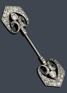 A BELLE EPOQUE DIAMOND JABOT PIN, France, circa 1890. Pin with arrow-like ends set with pear-shaped, rose- and old European-cut diamonds, mounted in rhodium-plated silver over gold. #BelleÉpoque #antique #jabot #pin