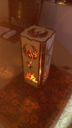 Cool lit view of a Phoenix Rising lamp. Get your own NOW! http://www.etsy.com/shop/LaserDesignEngraving