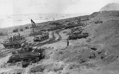 M4_Sherman_tanks_Equipment_for_Battle_coming_ashore_Iwo_Jima_3_February_1945