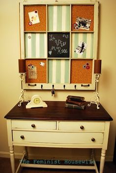 repurpose old window with cork, chalkboard, and fabric covered metal -- hooks are a nice touch