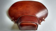 Hand made Lambretta ld front seat cover. Hand stitched veg tan leather with solid copper fittings.