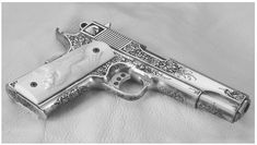 A magnificent Terry Tussey custom 45 auto fabricated from a Caspian Arms frame and slide. When finished, master engraver Eric Gold, who also carved the superb ivory grips, marvelously engraved the gun.