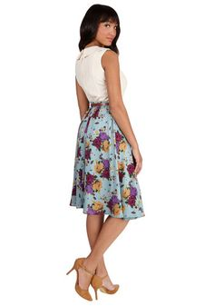 This morning, a bundle of bright flowers was waiting at your door. You excitedly scooped them up, deciding to wear this floral midi skirt - featuring a blue-hued base and vibrant blooms in purple, burgundy, and mustard - to match the beauty of their petals! You clasp the faux-leather belt through belt loops that sit along this bottom's fitted-back waistband and set out into your day looking as picturesque as the pretty flowers on your dresser!