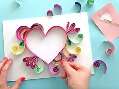 Paper hearts made by quilling are an extra special addition to any gift. So, what exactly is paper quilling? Get the full inst Quilling Images, Paper Quilling Cards, Paper Quilling Flowers, Quilled Paper Art, Paper Quilling Designs, Quilling Patterns, Quilling Instructions, Paper Quilling Tutorial, Paper Quilling For Beginners