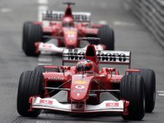 These Are the Most Beautiful F1 Cars Ever | Rubens Barichello leading teammate Michael Schumacher in the amazing Ferrari F1-2004 of 2004.  Ferrari  | WIRED.com
