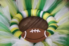 Custom Sports Tulle Wreath by ShopSoFi on Etsy, $25.00    Great idea for gifts for my sports loving family & friends.