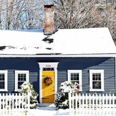 I wouldn't mind a blue Christmas in this house! So striking in the fresh-fallen snow. What's your favorite feature? In Amherst, NH. Best Front Door Colors, Yellow Front Doors, Best Front Doors, Painted Front Doors, Dark Blue Houses, Navy Houses, Dark House, Yellow Houses, Yellow House Exterior