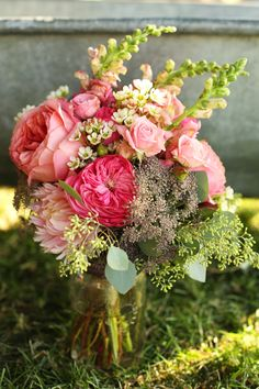 Lovely pink summer bouquet of roses, dahlias, and snapdragons -- shades of pink and green