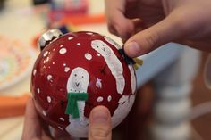 Snowmen ornaments. Great class gift idea jus pain their hand white and hold the ornament, then have them decorate it!