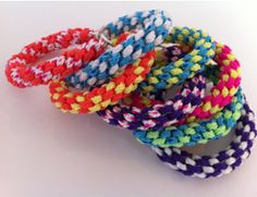 Arm Candy Woven Bracelets are perfect for summer days at the beach or backyard get-togethers on warm nights. This tutorial shows you how to make bracelets that pop by using lanyard and box braiding.