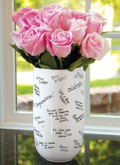 Bridal shower guest book idea: a vase! That way it is not in a book collecting dust.