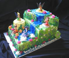 Tinkerbell with faries cake by Giggy's Cakes and Sweets, via Flickr