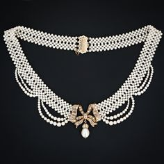 Love this Victorian necklace via Lang Antiques; the bow in the center is brilliant.