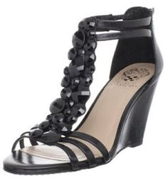 Leather upper in a T-strap wedge sandal style with a round open toe   Features charming stone detail   Full zip closure at heel   Smooth lining and lightly cushioned insole   Traction outsole   3 3/4 inch wedge heel