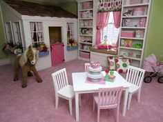 Decorating Ideas for Fun Playrooms and Kids' Bedrooms : What 4-year-old girl wouldn't love this sweet window-box laden playhouse? The Dutch door allows for parental supervision and a little privacy for her. (Mr. Ed the horse likes it too).  From DIYnetwork.com