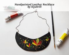 Jewelry that is meant to speak for itself, an unique way to display an artists work. Carefully hand painted with stylized floral patterns and worn on a simple shirt, this necklace will surely bring admiration. OOAK and available in my shop: bijubrill.etsy.com