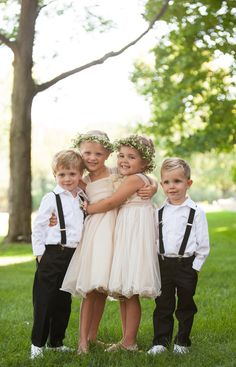 Flower girls stayed girly in ivory chiffon dresses accessorized with floral crowns. Ring bearers sported matching suspenders with white shirts and black slacks.